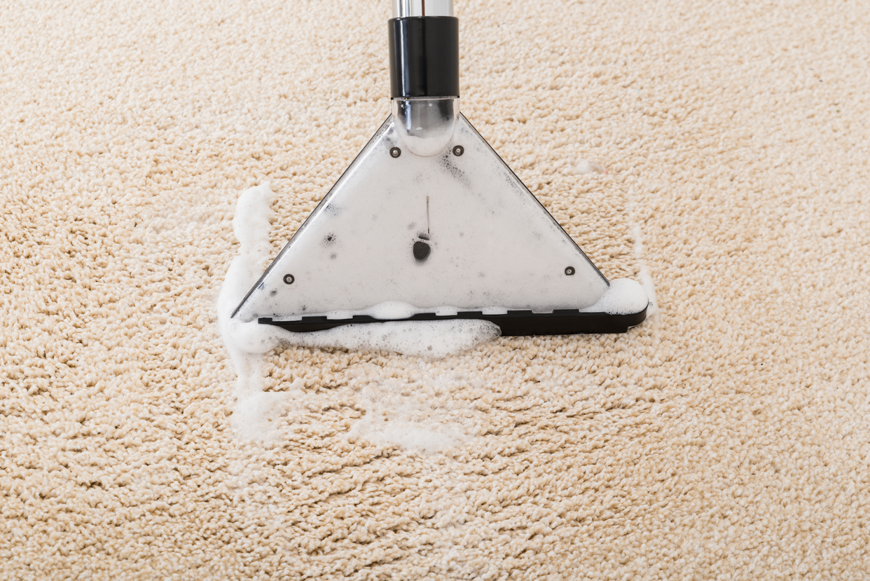 Upholstery cleaning over wet carpet